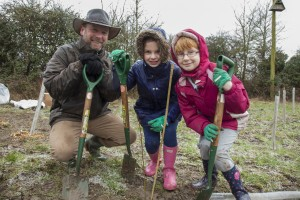 Children from Avonmouth in Bristol brave the cold for a 'One Tree Per Child' planting organised by Bristol council.