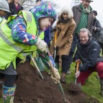 The Mayor helps some children to plant a tree in Eastville Park.