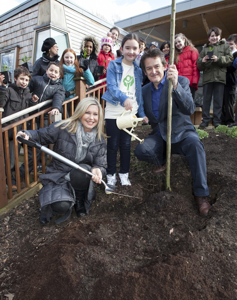 Estelle Dee planting the first 'One Tree Per Child' tree in Hyde Park with Olivia Newton-John and Jon Dee. A big thanks to the Isis Education Centre and Royal Parks!