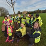 Time for a group photo around one of the 'One Tree Per Child' trees!